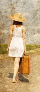 Lonely girl with suitcase at country road.. Photo in old image s